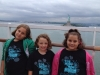 Micaela, Aly, and Marina on a cruise passing Lady Liberty